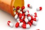 Medicine concept. Spilled pills from prescription bottle. 3d
